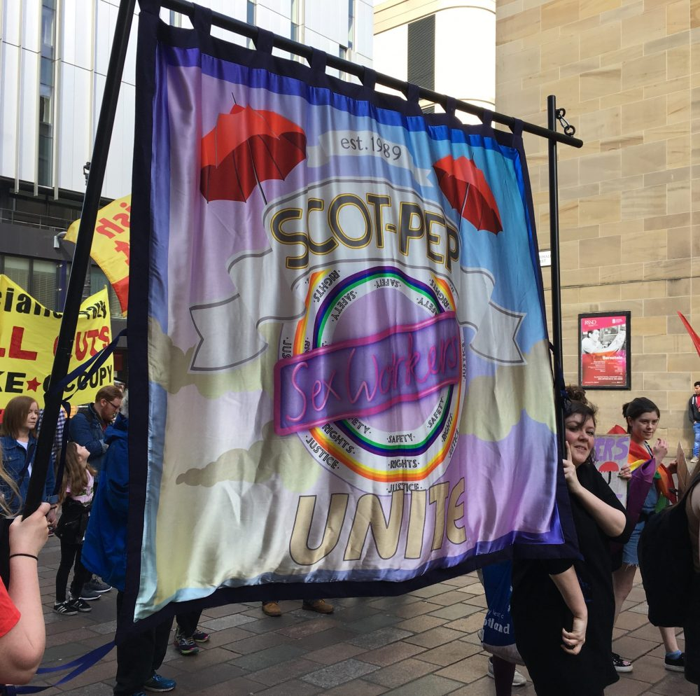 SCOT-PEP banner at a protest